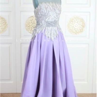 A lavish evening dress purple color with crystal and beads